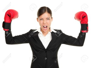 10437954-Boxing-gloves-business-woman-angry-business-concept-showing-aggressive-female-businessperson-flexing-Stock-Photo