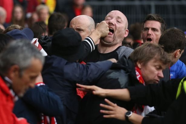 Liverpool-and-Sevilla-fans-fight-in-the-stands-before-the-Europa-League-Final