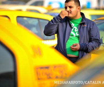 Taximetristii din București protestează împotriva UBER
